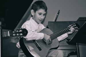 Lexington Childbloom student Connor Vincent on stage at a recital performance, December 2014.